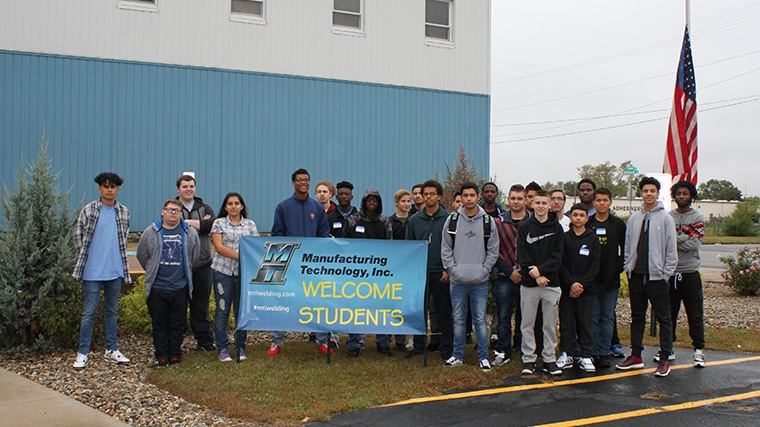 South Bend highschoolers pose in front of MTI in celebration of Manufacturing Day 2017.