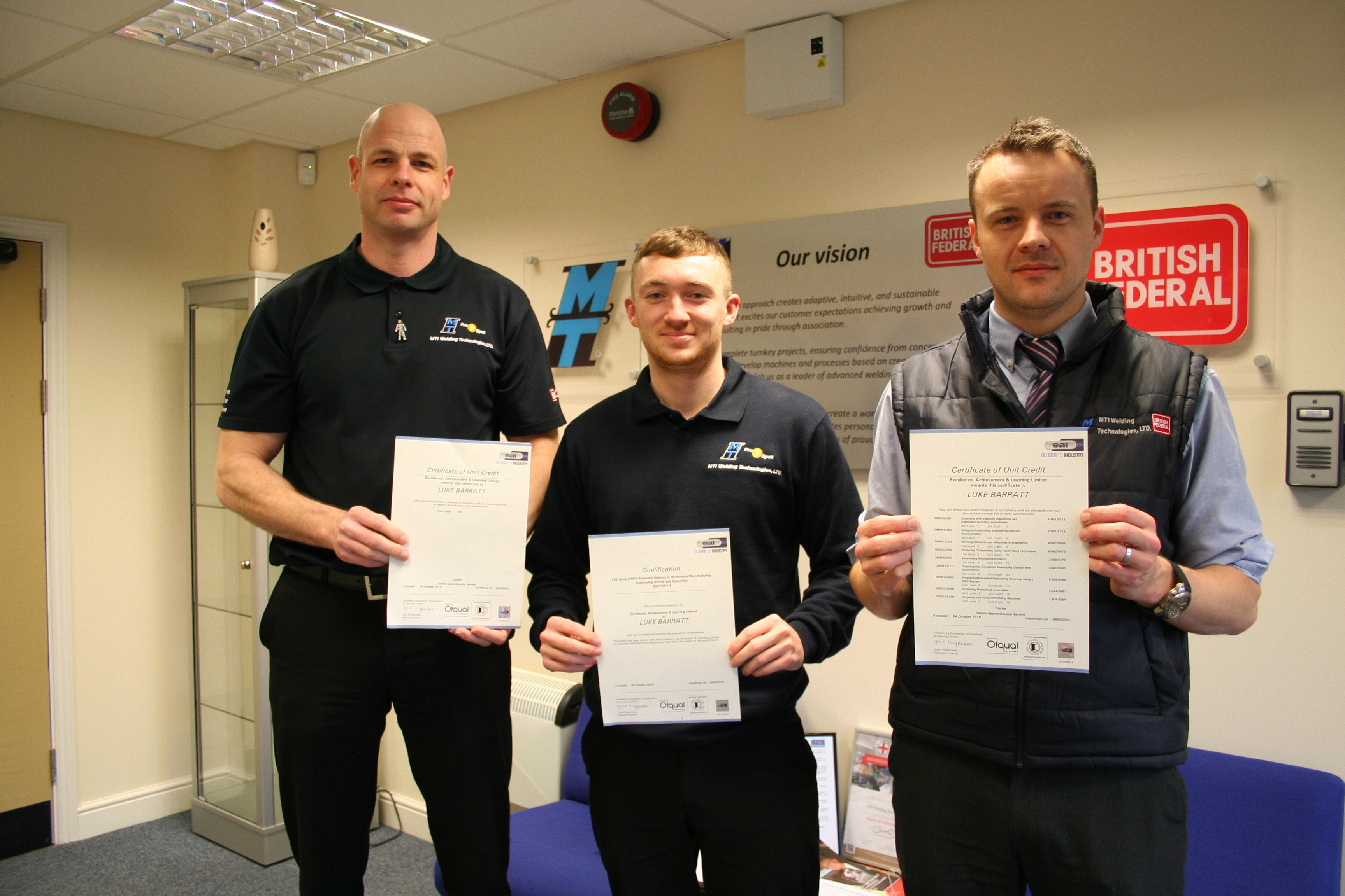 Junior design engineer Luke Barratt pictured with apprentice manager CHris Price and Nick Walford, the head of Luke's new engineering department.