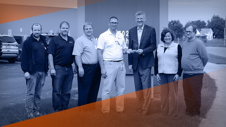 MTI accepts safety award from Amerisure and Gibson Insurance.