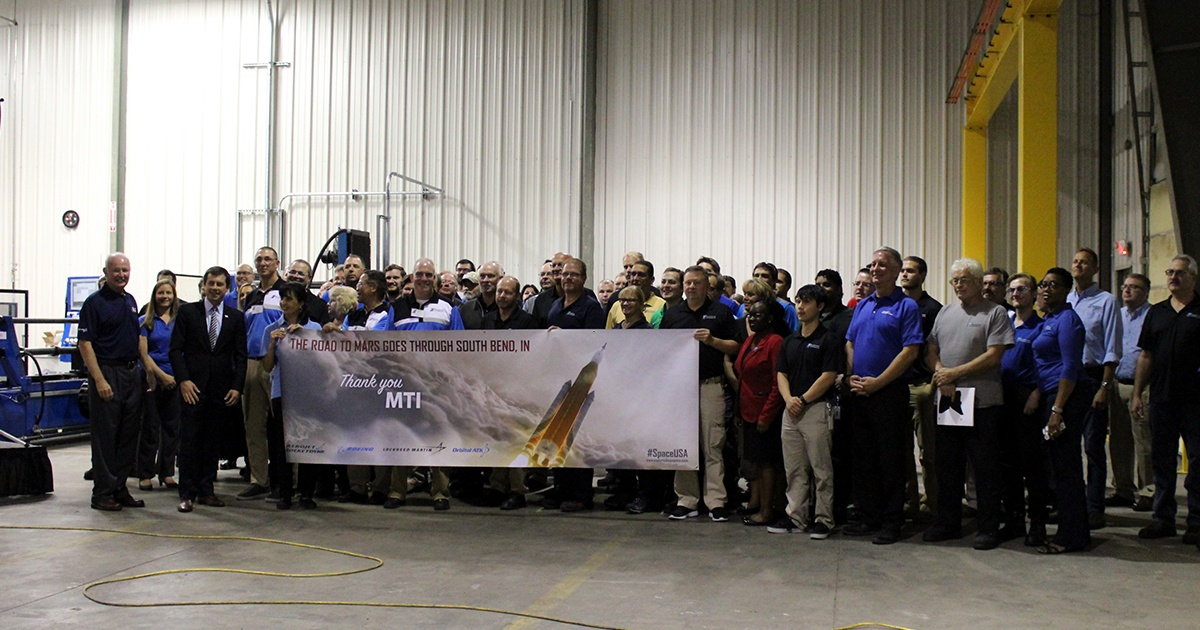 NASA and other key members present MTI with a banner for their efforts in the journey to Mars.